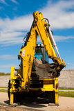 Excavator. Parked by the construction site royalty free stock photos