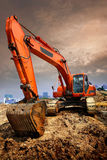 Excavator. Work at construction site with sunset background Royalty Free Stock Photography
