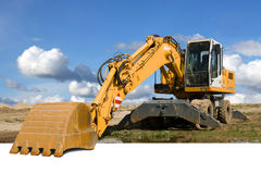 Excavator. Yellow excavator  at construction site Stock Photography