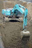 Excavator. Operating on a construction site Royalty Free Stock Photos