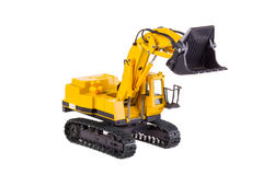 Excavator. Toy heavy excavator isolated over white background Stock Photography