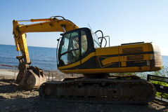 Excavator. A yellow excavator working on the beach of mediterranean sea,Cyprus Stock Photos