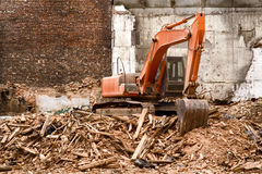 Excavator. At the ruins of old building stock image