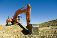 Excavator. In a road construction Stock Photos