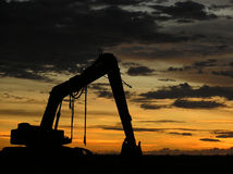 Excavator. A silhouette of an excavator during sunset stock images