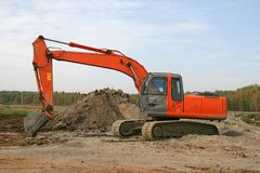 Excavator. Photo of a working excavator in the countryside Royalty Free Stock Photo