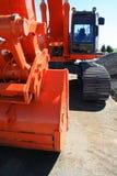 Excavator. Orange excavator close up on a construction sight Stock Image