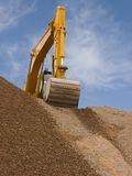 Excavator. On top of a dirt mound Stock Photography