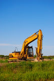 Excavator. Large excavator or backhoe near a construction site Stock Photo