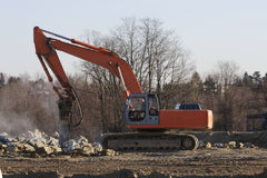 Excavator. Breaking Rocks Stock Photo