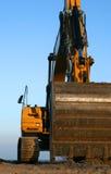 Excavator. Heavy construction equipment - a yellow excavator Stock Image