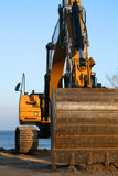 Excavator. Yellow excavator - spoon ready for digging in the ground Stock Image