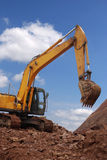 Excavator. Is on site excavation and construction work is very busy Royalty Free Stock Photography