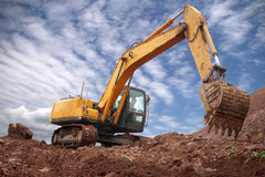 Excavator. Is on site excavation and construction work is very busy Royalty Free Stock Photos