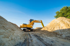 Excavator in action, the sand Royalty Free Stock Image