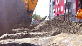 Excavator in action stock video footage