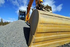 Excavator against blue sky Royalty Free Stock Photos