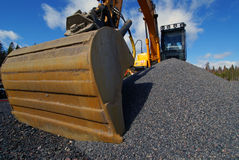 Excavator against blue sky Stock Photography