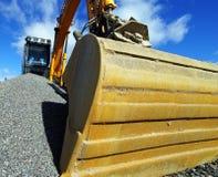 Excavator against blue sky Stock Photo