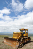Excavator against cloudy sky Royalty Free Stock Photography
