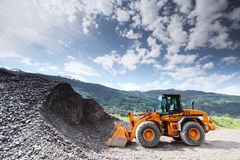 Excavator in alps Royalty Free Stock Images