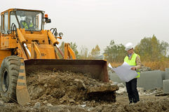 Excavator and architect. Stock Photography
