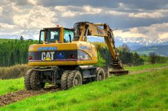Excavator in the area. Royalty Free Stock Images