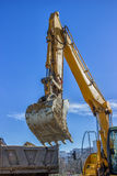 Excavator arm and dumper truck Royalty Free Stock Photo