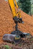 Excavator arm with Loader Clamshell Grab Bucket attached Stock Images