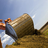 Excavator arm moving earth Royalty Free Stock Photo