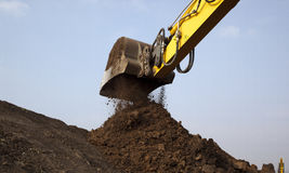 Excavator arm moving soil Royalty Free Stock Photo