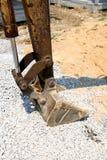 Excavator Arm on Construction Site. Excavator Arm with Rock and and on Construction Site Stock Photography