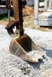 Excavator Arm on Construction Site. Excavator Arm with Rock and and on Construction Site Stock Image