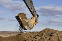 Excavator arm and scoop digging Stock Photo