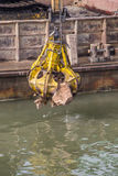 Excavator on barge with hydraulic rotator stone grab Royalty Free Stock Images