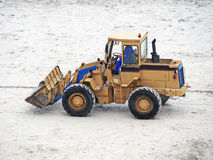 Excavator on the beach. An excavator parked on the sand royalty free stock photos