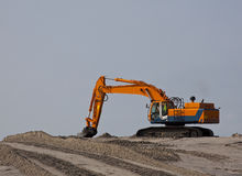 Excavator on beach. An excavator on the beach royalty free stock photos