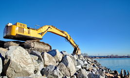 Excavator  on the beach Stock Images