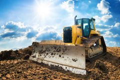 Excavator with blue sunny sky in the background Stock Photography