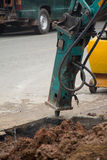 Excavator breaking and drilling the concrete road . Royalty Free Stock Photo