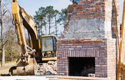 Excavator and Brick Chimney Aftermath of Tornado Royalty Free Stock Photography