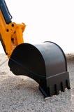 Excavator bucket. Close up of excavator bucket start to dig Royalty Free Stock Images