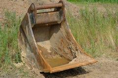 Excavator bucket. Parked excavator shovel in the area Stock Image