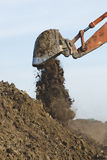 Excavator bucket. An excavator dumping a bucket of dirt Royalty Free Stock Photos