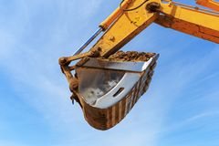 Excavator bucket againest the blue Sky Stock Image