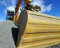 Excavator bucket against blue sky Royalty Free Stock Image