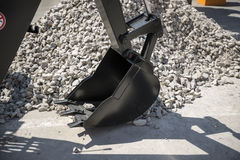 Excavator bucket on a background of rubble Stock Images
