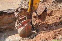 Excavator bucket  bulldozer work a hole the repair of pipe Royalty Free Stock Photography