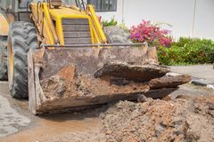 Excavator bucket  bulldozer work a hole the repair of pipe Stock Image