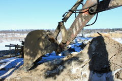 Excavator bucket close up in winter. Against the sky Royalty Free Stock Photos
